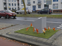 Kunstgras en bloemen bij ondergrondse container Krispijnseweg Dordrecht