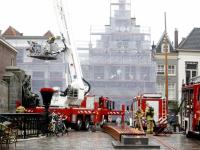 Brand in spouwmuur in woning binnenstad Voorstraat Dordrecht