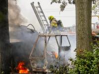 Graafmachine en container in brand Rijksstraatweg Dordrecht